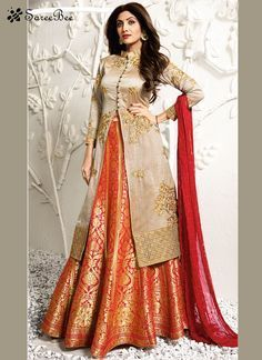 Be an angel and create and establish a smashing influence on everyone by wearing this Shilpa Shetty beige and orange jacquard, raw silk and viscose long choli lehenga. The lovely embroidered, resham a...