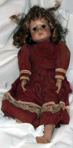 I would have been the first to admit to you I do not believe in haunted dolls. But since haunted Christina came into my life I no longer say it is not possible. Christina may not be that old she may not have the best of hair but this little darling is very haunted. I also know she is happy in the little rocking chair I bought her also. Her hair may be a great rats nest of a mess, but, yes she likes it that way. The lady who had had her before me... There's more to her story.. check it out
