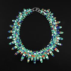 Reversible Multi-Stone Necklace by Charlene Reano Sterling Silver, Turquoise, Coral, Spiny Oyster Shell, Mother of Pearl, Clam Shell, Lapis, Denim Lapis, Abalone Shell, Onyx, Serpentine Tribe: San Felipe Pueblo, Santo Domingo Pueblo Ke-Wa