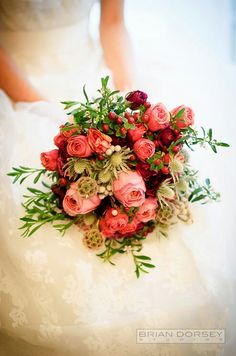 """Red English Garden Roses, Red Ranunculus, Pink """"Vintage"""" Roses, Pink Spray Roses, Red Hypericum Berries, Silver Brunia, Eryngium Thistle, Scabiosa Pods, White Snowberry + Several Varieties Of Green Foliage Complete This Pretty Bouquet"""
