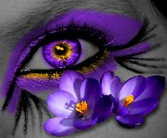 Purple flowers, purple eye-makeup, purple eyes.What more could a purple lover ask for?