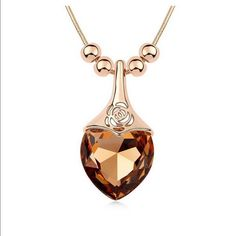 "Swarovski 14K Gold Filled 30"" Necklace NWT What a stunner! This chestnut colored Swarovski colored crystal drop pendant is accented with clear crystal pave diamond like Swarovski crystals. 100% Brand New, Never Used Give your look an edgy and endearing appeal, perfect for the fashionista on the go. Size Approx: 1.06"" by 2.32"", Chain Length Approx 30 inch Comes with a velvet jewelry gift pouch. Jewelry Necklaces"