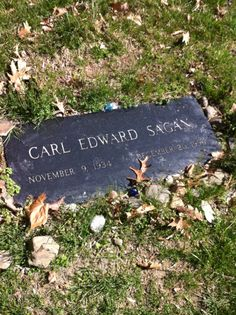 Carl Sagan's grave in Ithaca, NY. Note the little blue marbles left in remembrance. <3
