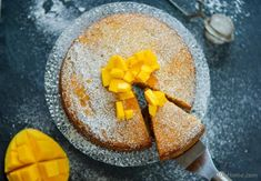 An easy and moist mango pound cake recipe. This moist, mango pound cake needs nothing more than a dusting of confectioner's sugar to set off it's classic loo. Mango Dessert Recipes, Mango Recipes, Desert Recipes, Sweet Recipes, Delicious Desserts, Yummy Food, Yummy Recipes, Mango Pound Cake Recipe, Clean Eating Sweets