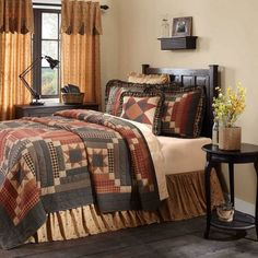 The Maisie Quilt features 8-point stars set in tan Irish chains of ditsy floral prints. Stout courthouse step blocks of country black and burgundy balance dainty floral patterns to create a look with wide appeal. courthouse step blocks are arranged to create lines of black and burgundy. Hand-quilted, 100% cotton, reverses to black and tan check found on front.