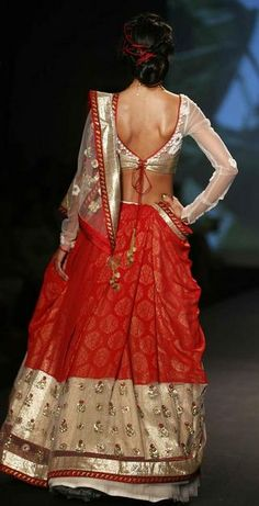 Classic red and gold. Don't miss the net sleeves and the red highlights in her hair. :) --- #indian #wedding #bridal