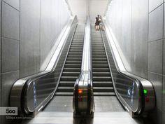 #red an green by MauritsdeGroen1  escalator gent trainstation woman MauritsdeGroen1