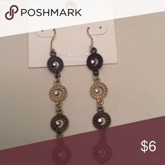 Long dangle lightweight earrings NWT 4 small multi color metal discs embellished with a tiny CZ stone they hang 2 inches long. New on original display card. Jewelry Earrings
