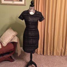 Beautiful black metallic dress Beautiful black/metallic dress. Full zipper back Collective Concepts Dresses Midi