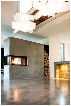 Beton ist modern, aber kalt - nein! Nicht mit einem BRUNNER Panorama Kamin. Schnelle und direkte Wärme mit einem Maximum an Feueratmosphäre. Hier gebaut als einzigartiger Raumteiler, für Feuergenuss von allen Seiten für dein Wohnzimmer.