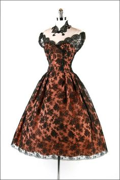 Vintage black lace and Peach. Warning: Pin doesn't lead to a website, only a picture. I don't know where this dress actually exists.