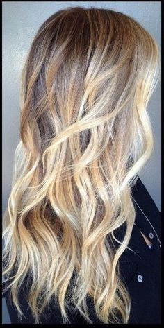 Long Beachy Waves | 11 Bombshell Blonde Highlights For Dark Hair - Best Hair Color Ideas by Makeup Tutorials at http://makeuptutorials.com/11-bombshell-blonde-highlights-dark-hair/