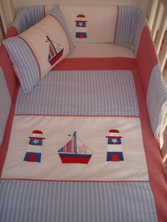 Nautical nursery linen - blue and red.  Cot bumper, quilt, fitted sheet for large cot, mini scatter cushion, baby change mat & 2 change mat covers.  All beautifully embroided on 100% cotton, we also use easy breathe cot bumper inners.  Contact us for prices and shipping terms.  We delivery nationwide within SA!!!