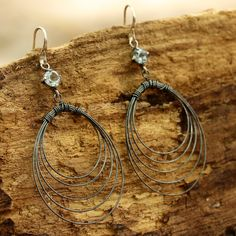 Oxidized  sterling silver wire wrap in teardrop shape earring with faceted round blue topaz in silver prongs setting,sterling silver hooks
