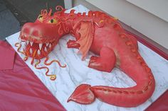 Red dragon cake by courtneyscakes, via Flickr