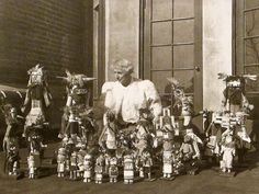 Max Ernst with his collection of Kachina dolls on the terrace of  Peggy Guggenheim's brownstone. I think that is Peggy's coat too if I am not mistaken....