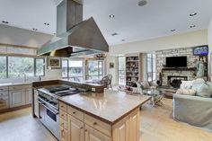 Fireplace in the kitchen area. Garden views. Memorial Villages Houston TX Real Estate - 2210 South Piney Point Rd
