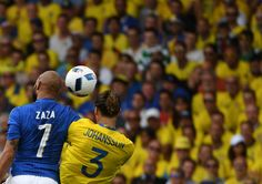Italy's forward Simone #Zaza (L) and Sweden's defender Erik Johansson vie for the ball during the Euro 2016 group E football match between Italy and Sweden at the Stadium Municipal in Toulouse on June 17, 2016. .Italy won the match 1-0. / AFP / PASCAL GUYOT