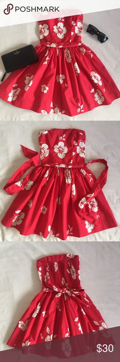 Red Floral Gilly Hicks Dress Like new red floral strapless Gilly Hicks dress. Worn only once. Comes with a removable matching belt. Gilly Hicks Dresses Strapless