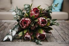 Beauty rich and rare: Native Australian bridal bouquets A luscious bouquet of frosted fire's mixed with gum and eucalyptus. I searched for this on /images Church Wedding Flowers, Cheap Wedding Flowers, Flower Bouquet Wedding, Floral Wedding, Protea Wedding, Purple Wedding, Wedding Ideas, Protea Bouquet, Wedding Bouquets