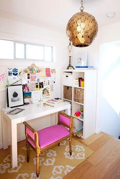 studio spaces: leah alexandra.  Nice use of small space, love the coat hanger tape storage