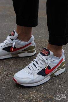 This Nike Air Pegasus 92 Premium is ready for the Rio 16 Olympics. It  sports the classic US colorway with a white base, University Red and  Midnight Navy ... 03d80fc110