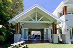 An Astonishing Entry Way With Hardwood Flooring And Glass Door With Grassy Field And Classic Rustic Wooden Bench Classic English house with modern details on the beach Rustic Wooden Bench, Southport, English House, Pool Houses, Farm Houses, Beach Houses, Beach Cottages, Loft, Facade House