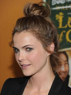 Keri Russell pulls her hair up into a high knot.