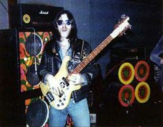 Lemmy with his amps from his Hawkwind days. Following his sacking from the band, he 'recovered' the amps and painted them black.