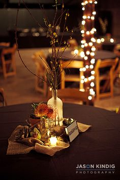 burlap and candles with orange things... but we could do purple