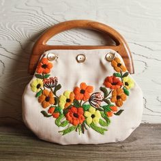 Pretty vintage floral. I had one of these purses when I was a pre-teen and I just loved it!