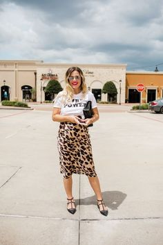 Houston fashion blogger wears a tee over her leopard slip dress and rockstud flats