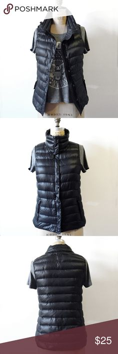 """Gap Light Puffer Vest in Black/Dark Navy Light down vest from the Gap in the darkest deep navy blue, some say black. Feather-filled funnel neck with toggles, two side zip pockets, front zip with wind barrior buttoned placket, slim fit for a great layereing piece. Approximate flat measurements: chest 18"""", top of shoulder to front hem 22"""". T shirt not included. Last photo compares it with black to show color. I cannot state that it is black because compared to black, it is definitely bluer…"""