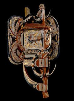 Mask made of wood, pigment, operculum, barkcloth, including bird, fish and snake forms. New Ireland, Papua New Guinea