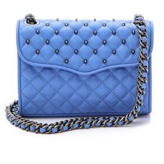 Quilted leather and matte finish studs construct a Rebecca Minkoff bag. Interwoven leather traces the chain strap, which can be worn long or doubled. The top f…