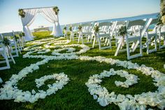 Outdoor chuppah on the lake with white draping and rose petal aisle runner found on Modern Jewish Wedding Blog // Photo by Photographer: NeriPhoto