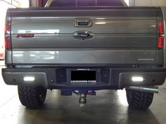 Flush mounted LED Back Up Lights on a Ford F150. These powerful LED lights will brighten up whatever is behind you. #truckaccessories