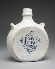 Flask (pilgrim bottle); tin-glazed earthenware; two broad flattened faces; narrow sides with two loop handles; neck; initials and date paint...1648