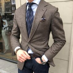 Brown blazer paired with an Italian linen striped tie.