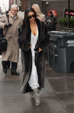 Kim Kardashian Rocks Luxurious Fur Coat and Edgy Snakeskin Booties in NYC -- See the Glam Look!