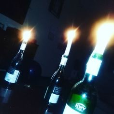 Three bottles of wine and three candles to make it all romantic