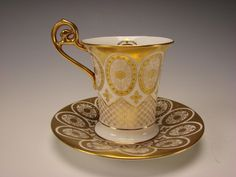 19c English Cauldon China  Hand Painted  Gilt Cup and Saucer