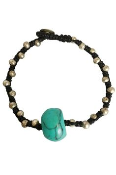 This simple summer fashion beaded bracelet, with a chunky turquoise stone, mixed with silver beads and threaded on black cotton makes the perfect accessory this summer.