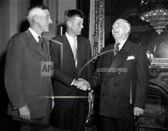 Vice President Alben Barkley, right, laughs at some remark made as he congratulated John Kennedy, center, new Democratic Senator from Massachusetts, after latter was sworn in at opening of 83rd Congress in Washington, D.C., Jan. 3, 1952. At left is Sen. Leverett Saltonstall (R-Mass.). (AP Photo)