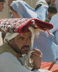 Kabul Street Life - unusual use for a rug