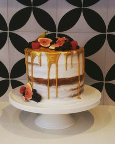 Semi Naked gold drip wedding cake witg fresh figs and berries