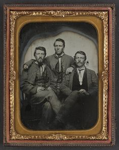 [Three unidentified soldiers in Confederate uniforms]  (LOC)