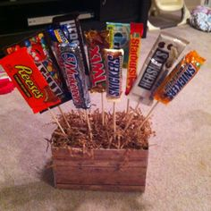 Super cute, easy, and cheap present for any occasion!! Skewers from walmart, strings and green floral foam from the dollar store, cardboard box, craft paper for the outside. Hot glue the candy to the skewers. Done :)