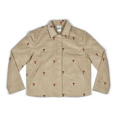 Limited 1/70.Cream corduroy jacket with mushroom embroideries. Made from high quality corduroy, lined with silk and embroidered with fly agaric mushrooms. The jacket features two buttoned slit pockets and one inside pocket. Note: these jackets are cropped and come up a bit small - please look at the sizing below and