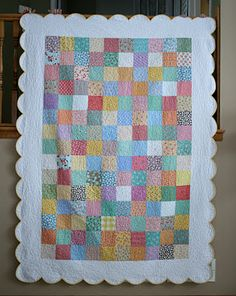 The scalloped border adds so much to a simple patchwork quilt.